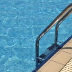 Vibrant Swimming Pool Side With Ladder